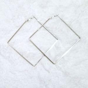 Oversized square diamond silver tone hoop earrings